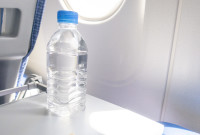 A bottle of water for drink on the aircraft